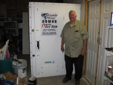Old man standing beside tornado alley safety room   Tips For Sheltering In Place